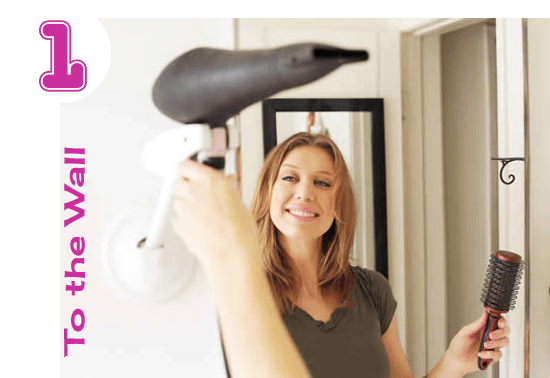 A woman using a hands free blow dryer holder